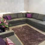 Living room in  muted shades of grey with purple accents